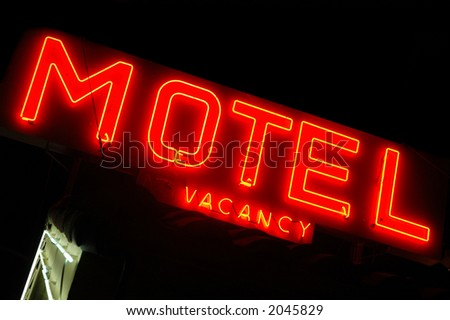 Motel sign lit up at night