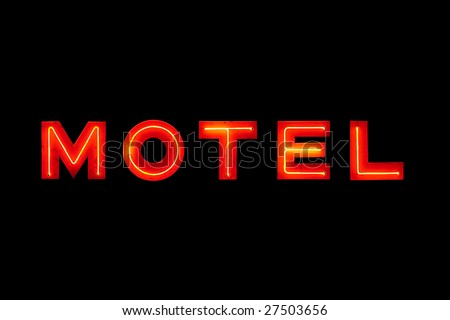 motel sign neon retro closeup isolated on solid black