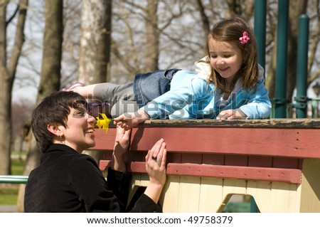 mother and a little girl playing in the playground