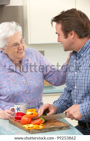 Mother and adult son preparing meal together