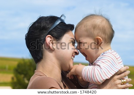 Mother and baby are laughing together.