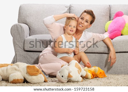 Mother and baby daughter playing 7