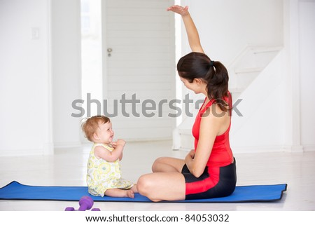 Mother and baby doing yoga