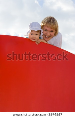 mother and baby hald red poster over sky with clouds