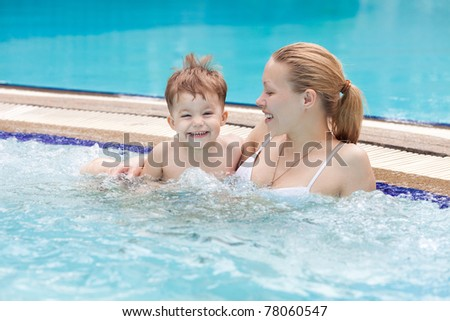 Mother and baby in a jacuzzi