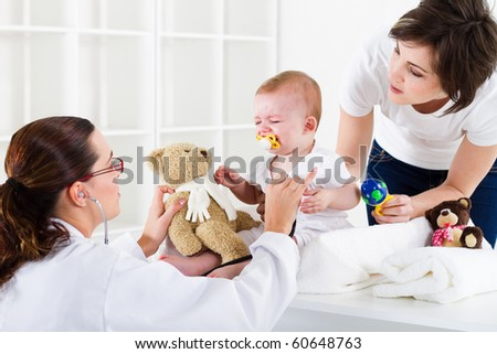 mother and baby in pediatrician office