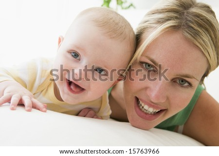 Mother and baby indoors smiling