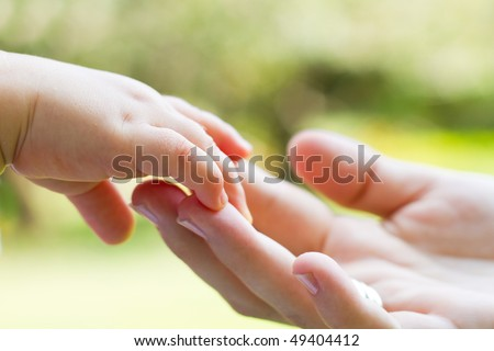 mother and baby\'s hands