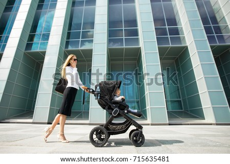 Mother and business woman talking on the phone while going to work #715635481