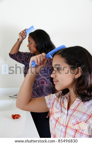 Mother and Child Brushing Their Hair Together