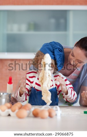 Mother and child doing Christmas baking and having fun