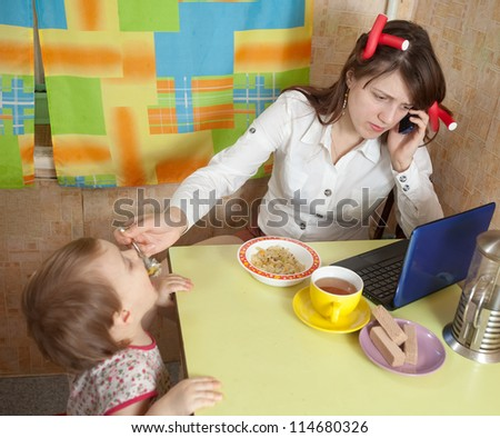 Mother and child eating breakfast in a hurry