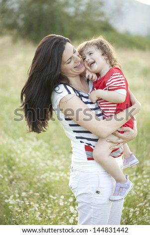 Mother and child enjoying summer