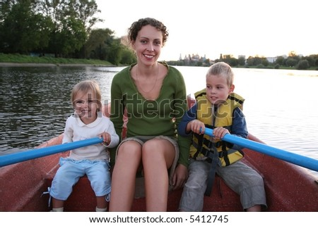 mother and child in the boat in the lake 2