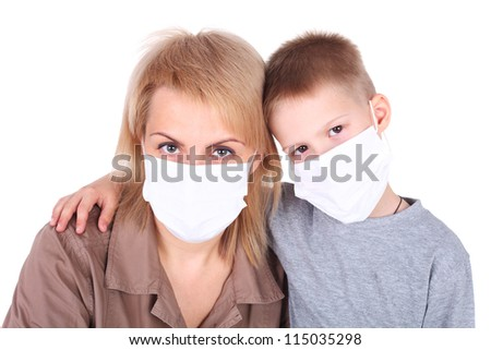 mother and child in the protective masks