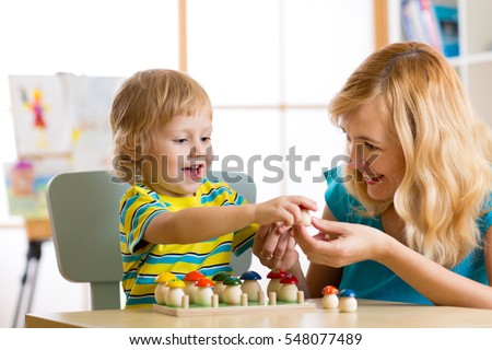Mother and child learn color, size, count while playing together. Early education concept.