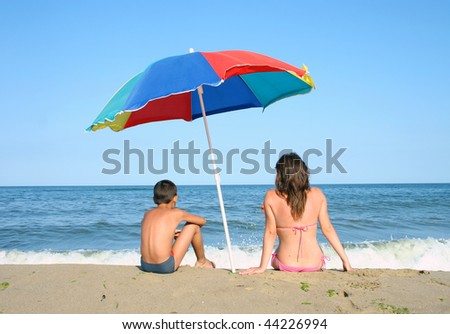 stock-photo-mother-and-child-on-beach-44226994.jpg