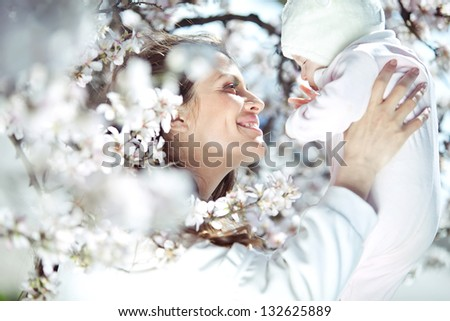 Mother and child outdoors portrait - stock photo