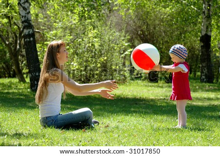 Mother and child play with ball