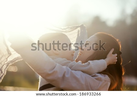 Mother and child playing in the park outdoor