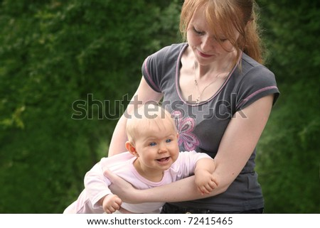 mother and child playing outdoor