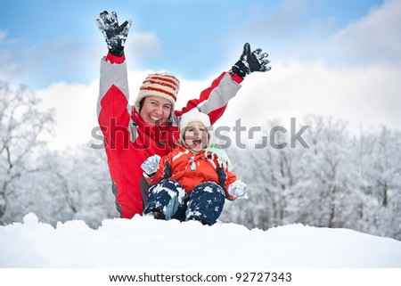 Mother and child playing with snow