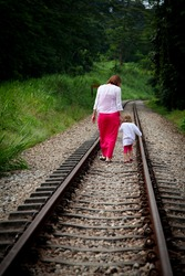 Mother and child taking a stroll along the abandoned railway.