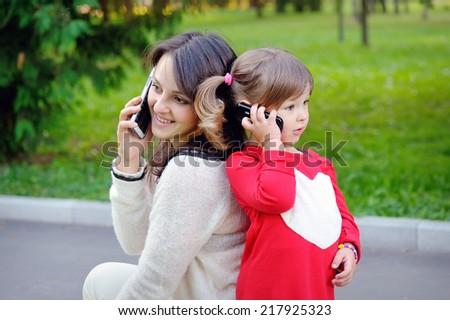 Mother and child talking on the phone