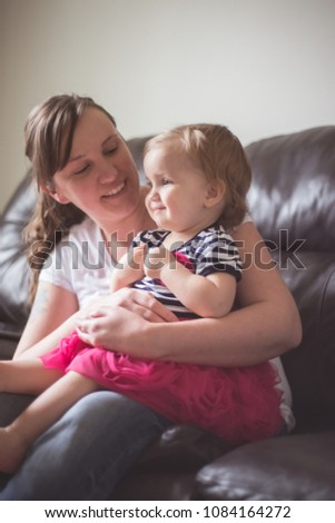 Mother and child together at home #1084164272