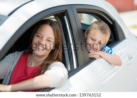 Mother and child waiting for something inside the car
