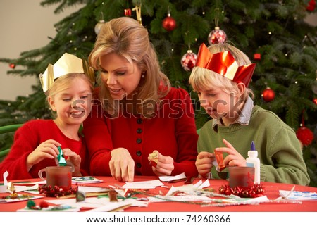 Mother And Children Making Christmas Cards Together