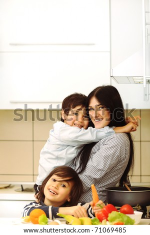 Mother And Children Preparing A meal, mealtime Together
