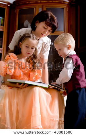 mother and children reading story-book
