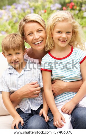 stock photo : Mother And Children Relaxing In Garden