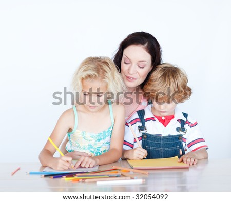 Mother and children writing together at home