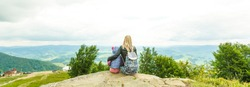 Mother and daughter admire beauty in the mountains