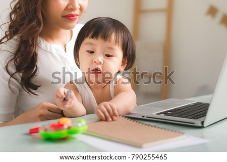 Mother and daughter are learning to write. #790255465