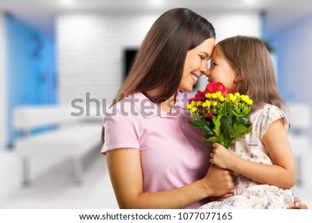 Mother and daughter at room #1077077165