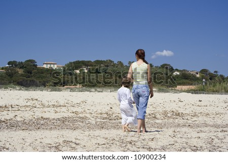 mother and daughter at the beach - saint-tropez, french riviera