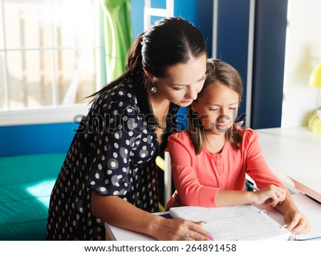 mother and daughter doing homework together