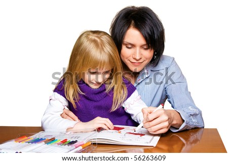 Mother and daughter drawing in the book, isolated on white