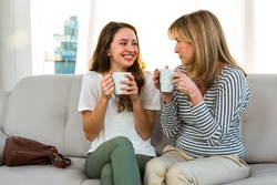 Mother and daughter drinking tea at home