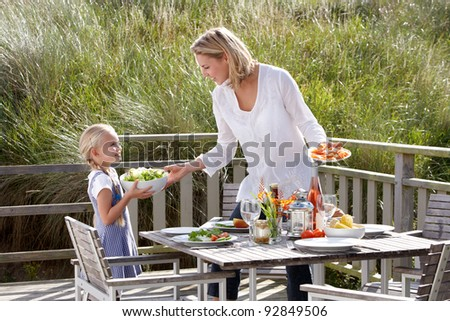 Mother and daughter eating outdoors