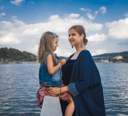 Mother and daughter enjoying at Xuan Huong Lake, Dalat, Vietnam