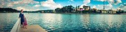 Mother and daughter enjoying at Xuan Huong Lake, Dalat, Vietnam. Panorama