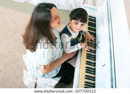 Mother and daughter enjoying their afternoon piano lesson