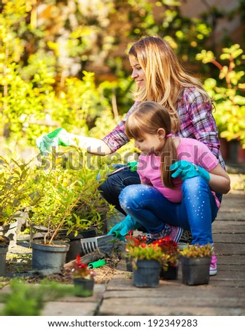 Mother and daughter gardening together.Family concept. #192349283