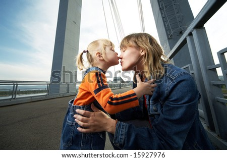 mother and daughter have a good time in the city
