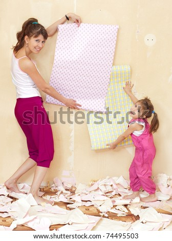 Mother and daughter have fun doing repairs