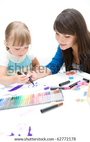 mother and daughter having fun in kindergarten